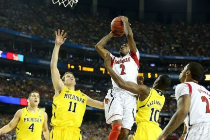Russ Smith drives for a shot attempt against Michigan. (Courtesy of ESPN)